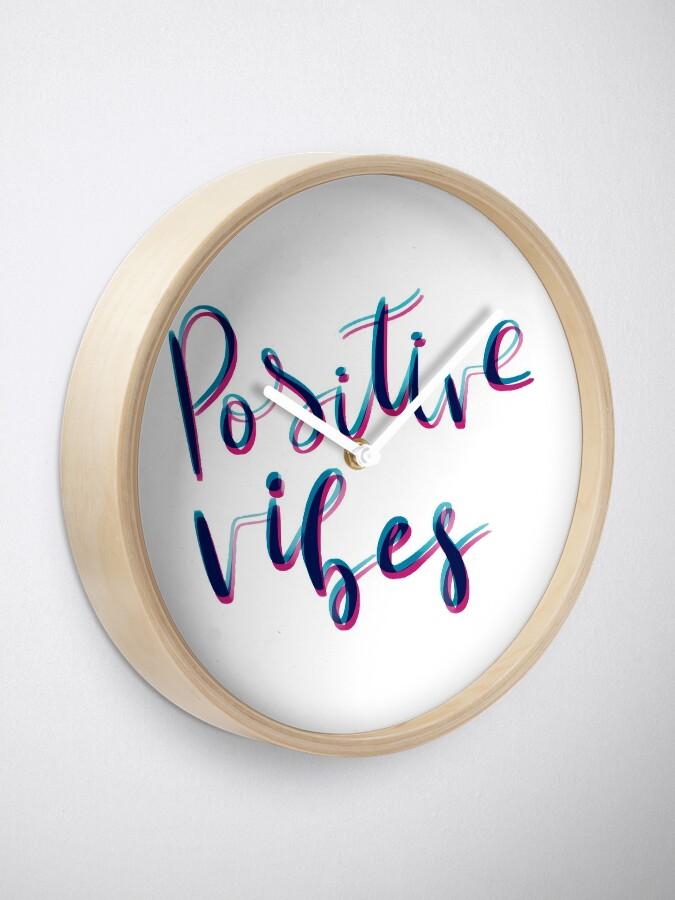 Vista alternativa de Reloj Vibras positivas
