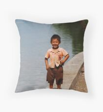 Smiling Balinese boy down by the river Throw Pillow