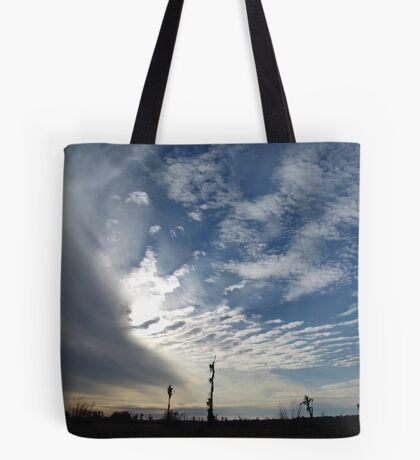 Blowing the Feathers Away Tote Bag