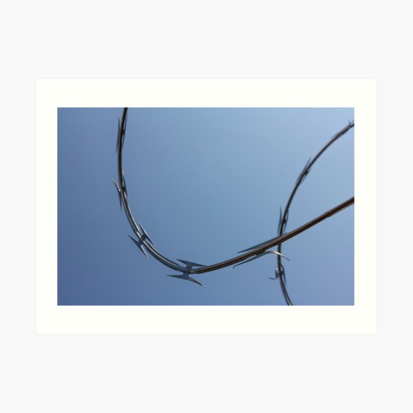 Razor wire silhouette against sky no.2 Art Print