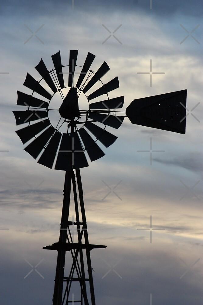 Kansas Windmill Silhouette with Sky by ROBERTDBROZEK