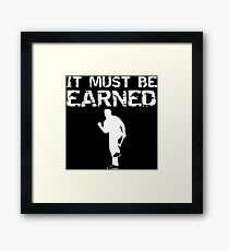 it must be earned Framed Print