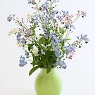 forget-me-nots in green vase by OldaSimek