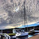 Yacht under a Dappled Sky by Tom Gomez