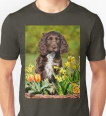 Spaniel puppy amidst spring flowers T-Shirt
