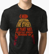 A man walks down the street... Tri-blend T-Shirt