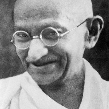 Gandhi in old age, with signature, smiling, wearing glasses, and with a white sash over his right shoulder by TOMSREDBUBBLE