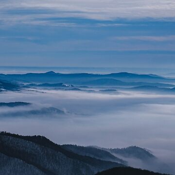 Misty winter Christmas morning over the mountain top  by monicamarcov
