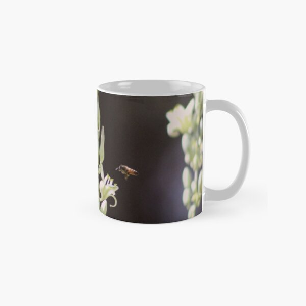 Bee Flying to Hesperaloe Parviflora Flower at Sunnyland Classic Mug