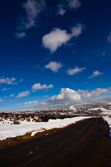 Snowy Scottish landscape with a road by Gabor Pozsgai