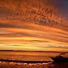 Boat in the sunset by Ian Berry