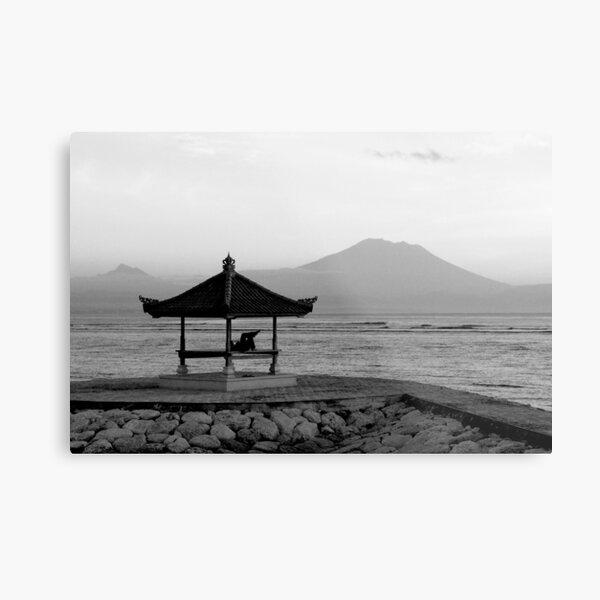 Lone figure in beachside pagoda, sacred mountain Gunung Agung in background. Bali, Indonesia Metal Print