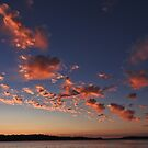 Puffy clouds at sunset by KateMcCSeattle