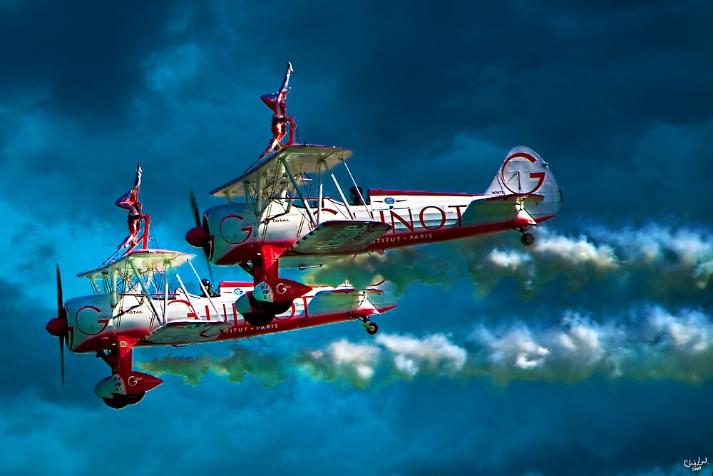 Daredevil Wingwalkers Do Headstands Above Biplanes by Chris Lord