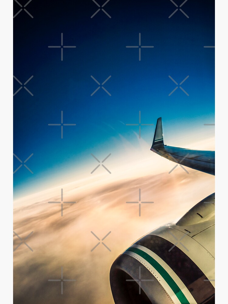 Sleek Jet Blue Sky Aerial by neptuneimages