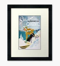 Vintage ski poster, woman skiing in Quebec Framed Print
