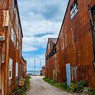 Rusty Buildings in Greenport by Michael Brewer