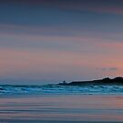 Sunrise over Bamburgh Castle, Northumberland by David Lewins