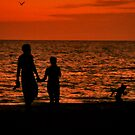 Silhouette of young couple with child by SERENA Boedewig