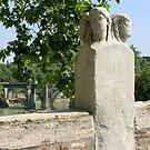 stone figures on Ponte Fabricio to Tiber Island, Rome by BronReid