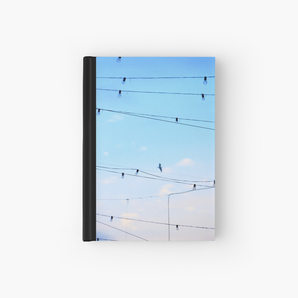 Right then a  few ideas occured to me whilst daydreaming of flying home finding harmony Hardcover Journal