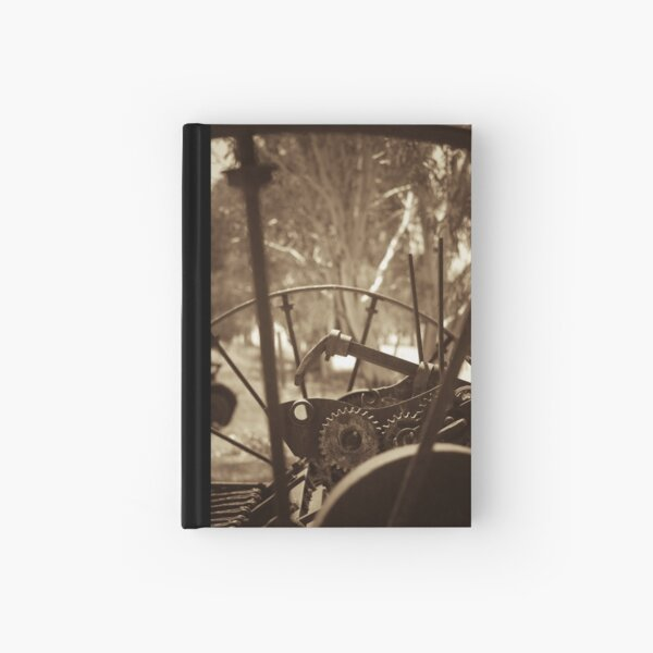Rusting farm equipment - sepia Hardcover Journal