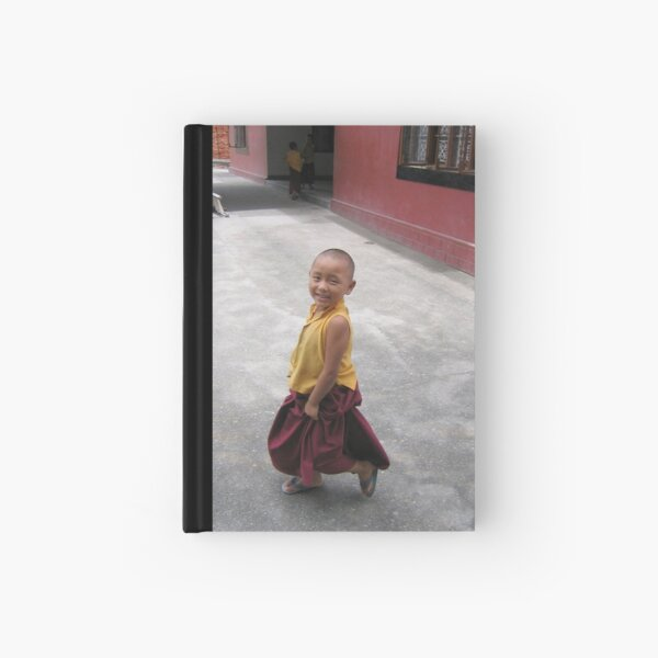 dancing by. young tibetan monk - india Hardcover Journal