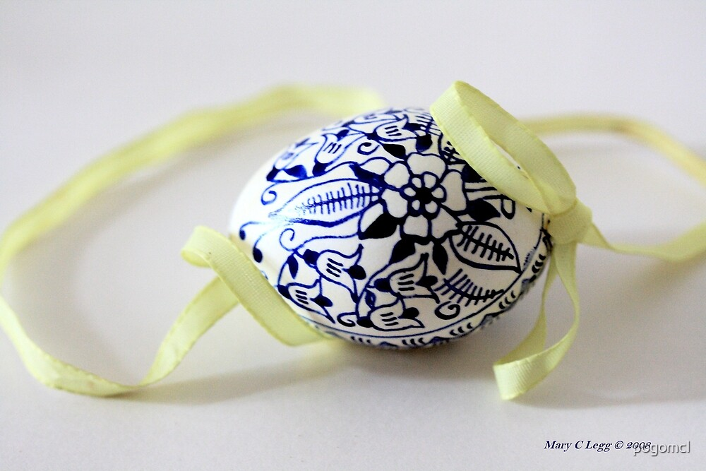 single tradtional Czech Easter egg with blue onion pattern and yellow ribbon by pogomcl