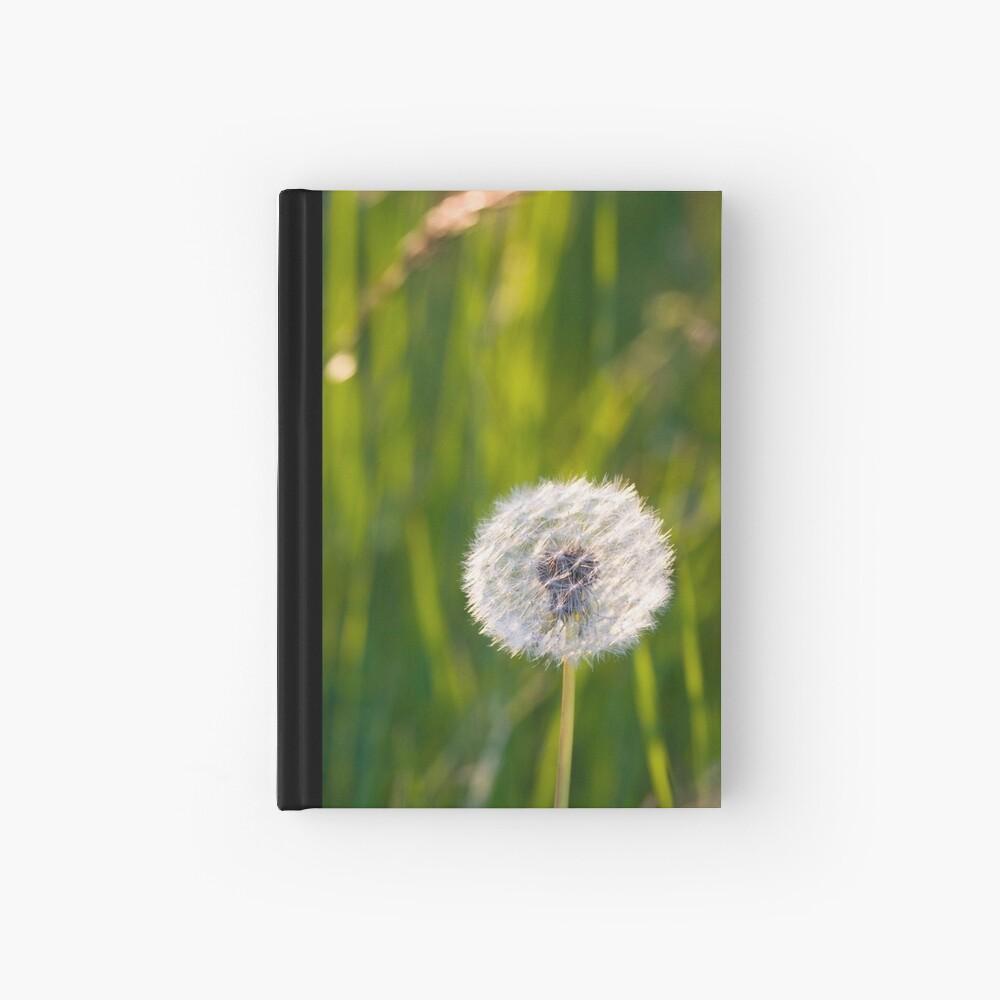 The lone dandelion Hardcover Journal