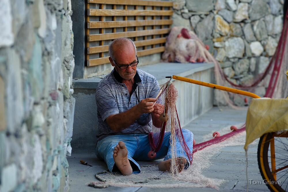 Fisherman fixing net in Monterosso, Cinque Terre, Italy by Tom Grieve