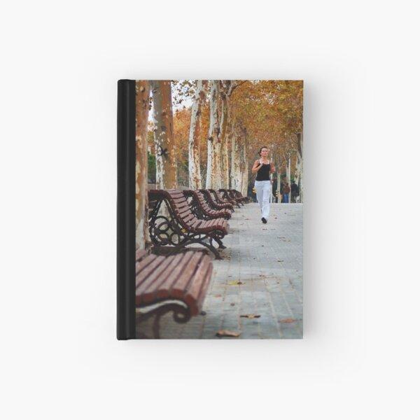 Girl Jogging in Barcelona Park Hardcover Journal