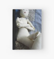 doll with no hair Hardcover Journal