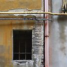 yellow wall with pipes and wires by fabio piretti