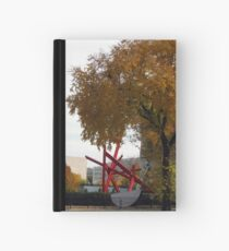 Red Sculpture in Fall  Hardcover Journal