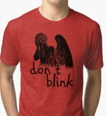 don't blink! Tri-blend T-Shirt