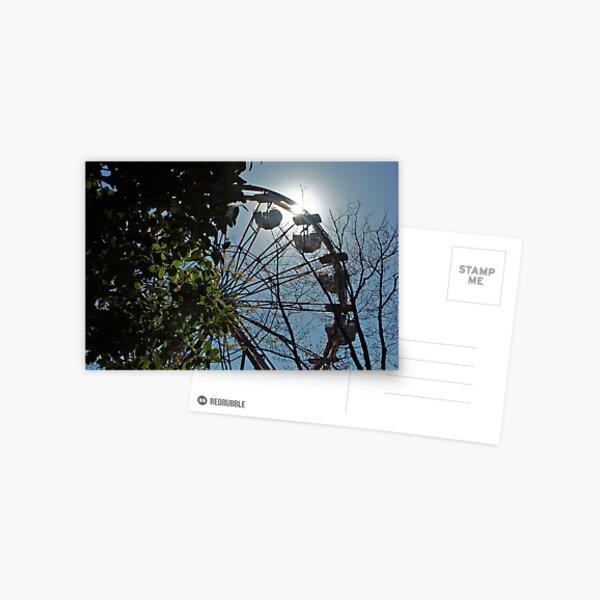 Sun behind the ferris wheel Postcard