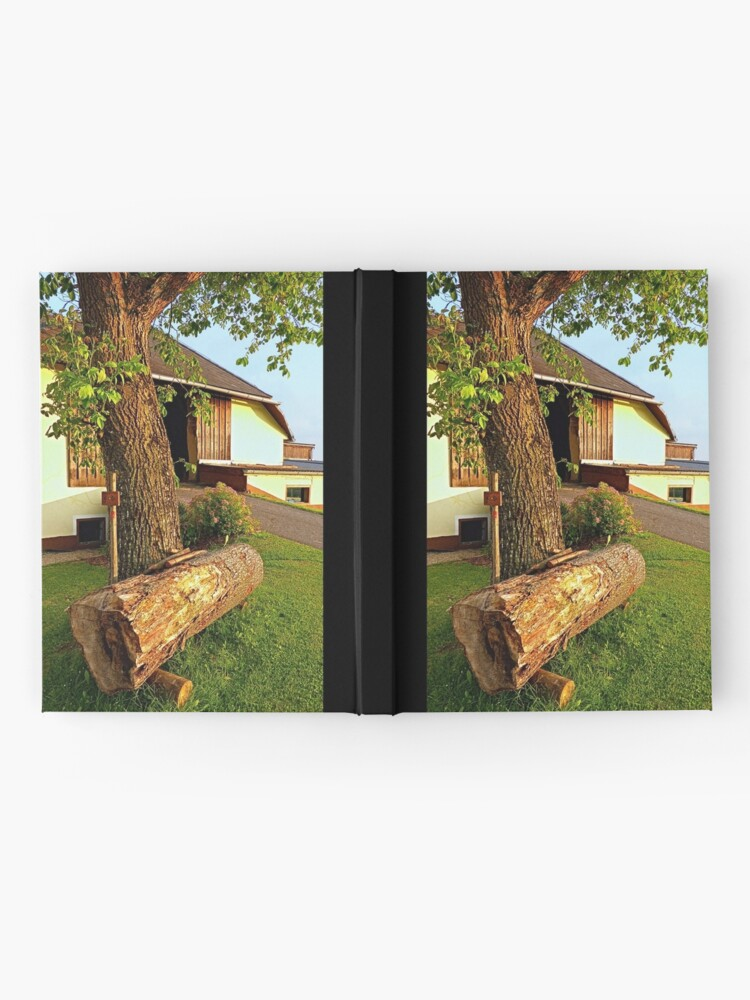 Alternate view of Tree trunk bench on a summer evening | landscape evening Hardcover Journal