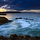 St. Abbs Head, viewed from Eyemouth at Sunset by David Lewins