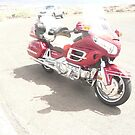A Red & Chrome Two Wheel Motorbike. by Mywildscapepics