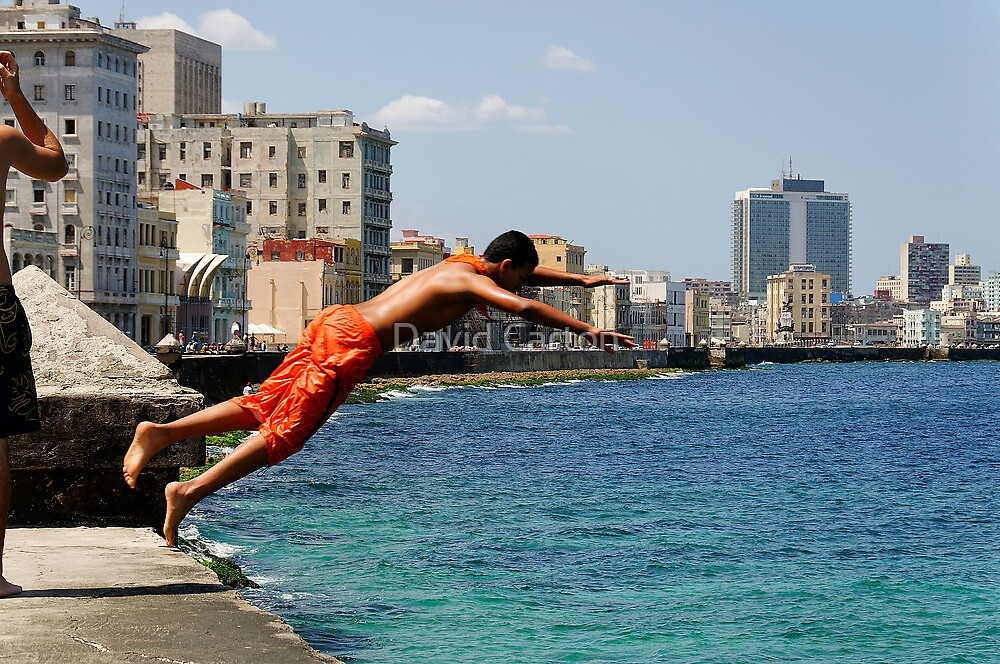 Locals diving off the Malecon, Havana, Cuba by David Carton