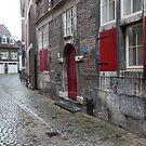 Wet cobblestone street in Maastricht, Netherlands by Jeff Hathaway