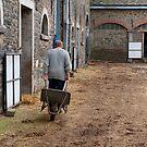 Man pulling a wheelbarrow by Jeff Hathaway