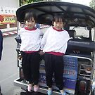 Twin Girls Standing on the Back of a Tuk Tuk. by Mywildscapepics