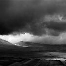 storm clouds over the Piano Grande, Umbria, Italy by Andrew Jones