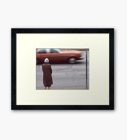 Waiting for a chance to cross. Framed Print