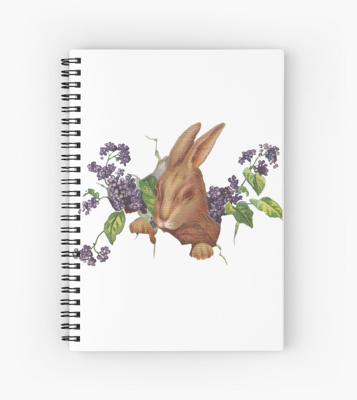 Ostern-Kaninchen, das vom Hintergrund mit Fliedern platzt von Colleen Cornelius