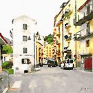 Road between buildings with cars by Giuseppe Cocco