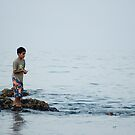 Omani boy, sea fishing from the rocks by MattGrover