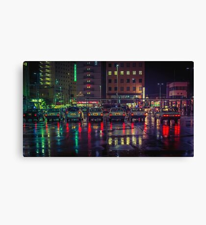 Taxi stand in the rain Canvas Print