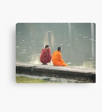 Two monks having a quite minute at sunset at Angkor Wat Cambodia Canvas Print